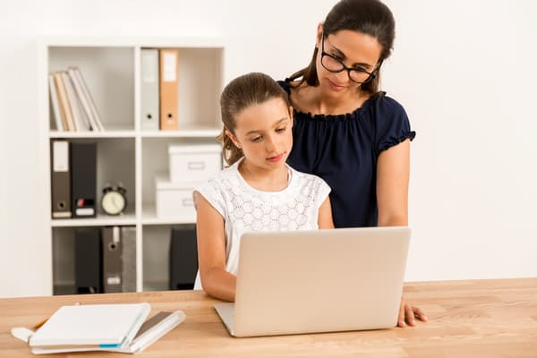 Mom helping daughter with virtual learning